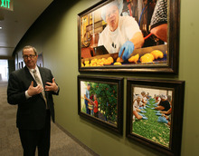 Steve Griffin     The Salt Lake Tribune   Richard Humpherys, manager of the LDS Church's new Bishop's Central Storehouse Salt Lake City, Utah, talks about the services the storehouse provides in a hallway lined with pictures  at the storehouseTuesday, March 6, 2012.