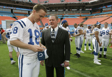 FILE - In this Jan. 30, 2007, file photo, Indianapolis Colts quarterback Peyton Manning, left, chats with Colts owner Jim Irsay during media day for NFL football's Super Bowl XLI at Dolphin Stadium in Miami. The Peyton Manning era in Indianapolis is expected to end, according to a report. Citing anonymous sources, ESPN reported Tuesday, March 7, 2012, that the Colts plan to hold a news conference Wednesday to announce the long-expected decision. Manning is expected to attend. (AP Photo/Michael Conroy, File)