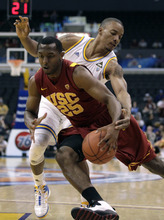 Southern California's Byron Wesley(25) is pressured by UCLA's Norman Powell during the first half of an NCAA college basketball game at the Pac-12 Conference tournament in Los Angeles, Wednesday, March 7, 2012. (AP Photo/Jae C. Hong)