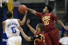 Southern California's Maurice Jones(10) blocks a shot by UCLA's Jerime Anderson(5) during the first half of an NCAA college basketball game at the Pac-12 Conference tournament in Los Angeles, Wednesday, March 7, 2012. (AP Photo/Jae C. Hong)
