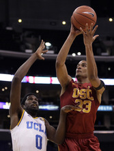 Southern California's Garrett Jackson (33) shoots against UCLA's Anthony Stover (0) during the first half of an NCAA college basketball game at the Pac-12 Conference tournament in Los Angeles, Wednesday, March 7, 2012. (AP Photo/Jae C. Hong)