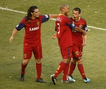Trent Nelson  |  The Salt Lake Tribune Real Salt Lake's Luis Gil, right, celebrates his goal with teammates Real Salt Lake's Fabian Espindola, left, and Real Salt Lake's Robbie Russell. Real Salt Lake vs. New York Red Bulls at Rio Tinto Stadium in Sandy, Utah. Saturday, August 6, 2011.