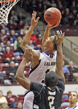 Weber State guard Damian Lillard (1) looks goes up under the basket in front of Portland State guard Charles Odum (2) during the second half  of an NCAA college Big Sky Tournament basketball game in Missoula, Mont., on Tuesday, March 6, 2012.(AP Photo/ Michael Albans)