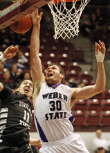 Weber State forward Darin Mahoney (30) goes up under the basket in front of Portland State forward Chehales Tapscott (11) during the first half of an NCAA Big Sky Tournament college basketball game in Missoula, Mont., on Tuesday, March 6, 2012.(AP Photo/ Michael Albans)