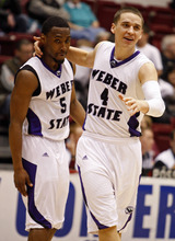 Weber State guard Scott Bamforth (4) and guard Jordan Richardson (5) celebrate at the end of a 69-63 win against Portland State in an NCAA college Big Sky Tournament basketball game in Missoula, Mont., on Tuesday, March 6, 2012.(AP Photo/ Michael Albans)