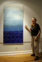 Francisco Kjolseth | The Salt Lake Tribune Utah artist Anna Bliss, pictured in front of her painting