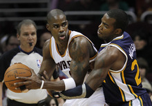 Cleveland Cavaliers' Antawn Jamison, left, pushes to the lane against Utah Jazz's Paul Millsap (24) in the first quarter of an NBA basketball game in Cleveland on Monday, March 5, 2012. (AP Photo/Amy Sancetta)