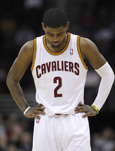 Cleveland Cavaliers' Kyrie Irving stands on the court in the second half of an NBA basketball game against the Utah Jazz in Cleveland on Monday, March 5, 2012. The Jazz won 109-100. (AP Photo/Amy Sancetta)