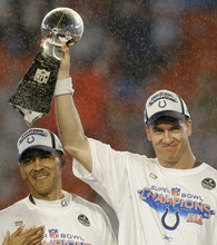 In this Feb. 4, 2007, file photo, Indianapolis Colts quarterback Peyton Manning lifts the Vince Lombardi Trophy beside coach Tony Dungy following the Super Bowl XLI football game against the Chicago Bears at Dolphin Stadium in Miami. The Peyton Manning era in Indianapolis is expected to end, according to a report. Citing anonymous sources, ESPN reported Tuesday, March 7, 2012, that the Colts plan to hold a news conference Wednesday to announce the long-expected decision. Manning is expected to attend. (AP Photo/Chris O'Meara, File)