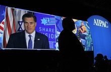 Republican presidential candidate, former Massachusetts Gov. Mitt Romney, seen on screen, speaks before the American Israel Public Affairs Committee (AIPAC), via satellite in Washington on Tuesday, March 6, 2012. (AP Photo/Charles Dharapak)