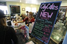 Francisco Kjolseth  |  The Salt Lake Tribune Courtney Hurdman gives change as she attends to customers at City Cakes Bakery, a vegan business in Salt Lake City.