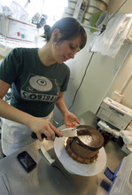Francisco Kjolseth  |  The Salt Lake Tribune Emily Saunders puts the finishing touches on a cake at City Cakes Bakery, part of a wave of vegan retailers earning the city a nod in