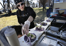 Scott Sommerdorf  |  The Salt Lake Tribune              Larayne Clegg puts the garnish on some vegan tacos at her Union Street Eats, a vegan food cart, across the street from the Main Library, Sunday, March 4, 2012.