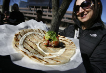 Scott Sommerdorf  |  The Salt Lake Tribune              Customer Martie Nightingale is happy with her vegan quesadilla from Union Street Eats, a vegan food cart, run by Larayne Clegg, across the street from the Main Library.