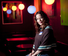 Michael Mangum  |  Special to The Salt Lake Tribune   Larayn Clegg poses before the March 2 meeting of Vegan Drinks, a social networking group for vegans, vegetarians and their friends, at W Lounge in Salt Lake City.