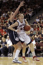 Gonzaga's Katelan Redmon, right, drives around BYU's Kristen Riley in the first half during the NCAA West Coast Conference tournament championship basketball game, Monday, March 5, 2012, in Las Vegas.  (AP Photo/Julie Jacobson)