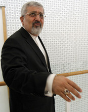 Iran's ambassador to the International Atomic Energy Agency, IAEA, Ali Asghar Soltanieh leaves the IAEA board of governors meeting at the International Center, in Vienna, Austria, on Thursday, March 8, 2012. (AP Photo/Ronald Zak)