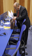 Israel's Ambassador to the International Atomic Energy Agency, IAEA, Ehud Azoulay prepares documentation for the IAEA board of governors meeting at the International Center, in Vienna, Austria, on Thursday, March 8, 2012. (AP Photo/Ronald Zak)
