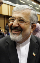 Iran's ambassador to the International Atomic Energy Agency, IAEA, Ali Asghar Soltanieh laughs prior to the start of the IAEA board of governors meeting at the International Center, in Vienna, Austria, on Thursday, March 8, 2012. (AP Photo/Ronald Zak)