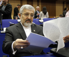 Iran's ambassador to the International Atomic Energy Agency, IAEA, Ali Asghar Soltanieh checks his papers prior to the start of the IAEA board of governors meeting at the International Center, in Vienna, Austria, on Thursday, March 8, 2012. (AP Photo/Ronald Zak)