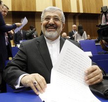Iran's ambassador to the International Atomic Energy Agency, IAEA, Ali Asghar Soltanieh waits for the start of the IAEA board of governors meeting at the International Center, in Vienna, Austria, on Thursday, March 8, 2012. (AP Photo/Ronald Zak)