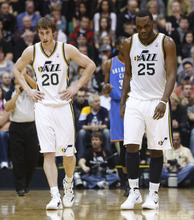 Trent Nelson  |  The Salt Lake Tribune Utah Jazz forward Gordon Hayward (20) and center/forward Al Jefferson (25) walk to the bench as a timeout is called with the Thunder leading 72-62 in the third quarter. Utah Jazz host the Oklahoma City Thunder, NBA basketball at EnergySolutions Arena Friday, February 10, 2012 in Salt Lake City, Utah.