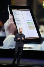 Apple CEO Tim Cook speaks during an event in front of a screen showing the iPad 2 in San Francisco, Wednesday, March 7, 2012. Apple is expected to reveal a new iPad model at Wednesday's event in San Francisco.  (AP Photo/Paul Sakuma)