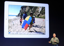 Apple's senior vice president of Worldwide Marketing Phil Schiller talks about the new iPad during an event in San Francisco, Wednesday, March 7, 2012.  The new iPad features a sharper screen and a faster processor.  Apple says the new display will be even sharper than the high-definition television set in the living room. (AP Photo/Jeff Chiu)
