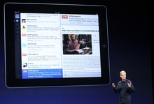Apple CEO Tim Cook introduces the new iPad during an event in San Francisco, Wednesday, March 7, 2012.  The new iPad features a sharper screen and a faster processor.  Apple says the new display will be even sharper than the high-definition television set in the living room. (AP Photo/Jeff Chiu)