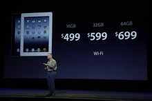 Senior vice president of Worldwide Marketing Phil Schiller announces new pricing for new iPad during an Apple event in San Francisco, Wednesday, March 7, 2012.  The new iPad features a sharper screen and a faster processor.  Apple says the new display will be even sharper than the high-definition television set in the living room.  (AP Photo/Paul Sakuma)