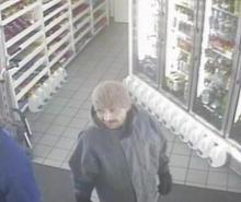 An image from surveillance video shows the suspect in a daytime robbery at a downtown Salt Lake City Chevron station.
