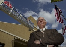 Damian Dovarganes  |  The Associated Press Realtor Mark Prather at his real estate services company, ERA Buy America Real Estate offices, in La Palma, Calif.