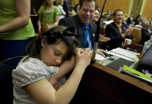 Scott Sommerdorf  |  The Salt Lake Tribune              Young Alayna Hutchings, daughter of Rep. Eric Hutchings, R-Kearns fell asleep as the Legislature ended it's business in the Utah House of Representatives, Thursday, March 8, 2012.