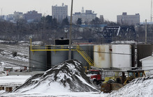 FILE - In this Wednesday, Jan. 4, 2011 file photo, a brine injection well owned by Northstar Disposal  Services LLC is seen in Youngstown, Ohio, with the skyline of Youngstown in the distance. A dozen earthquakes in northeastern Ohio were almost certainly induced by injection of gas-drilling wastewater into the earth, state regulators said Friday, March 9, 2012 as they announced a series of tough new rules for drillers. (AP Photo/Amy Sancetta, File)