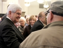 Republican presidential candidate, former House Speaker Newt Gingrich talks with residents of Meridian, Miss., after speaking to a crowd at the Mississippi State University Riley Center in downtown Meridian  on Friday, March 9, 2012. (AP Photo/The Meridan Star, Paula Merritt))