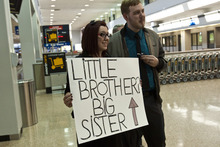 Chris Detrick  |  The Salt Lake Tribune Stephanie Cook and her husband, Trevin Cook, wait to meet her brother Thomas Linton for the first time at the Salt Lake City International Airport Thursday. Stephanie Cook was 1 year old when her mother, Bobbi Ann Campbell, gave birth to a boy. Days later, Bobbi placed the boy for adoption. Four years later, Bobbi disappeared and police have yet to resolve what happened to her. Stephanie, 22, was raised by her great-grandparents, while her brother grew up in Mapleton. When she was a teenager, she came across infant photos of her brother, whom she knew was named Thomas. She always thought he grew up in Seattle. But in January she randomly googled