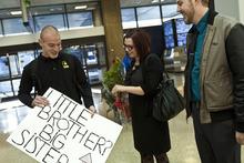 Chris Detrick  |  The Salt Lake Tribune Stephanie Cook and her brother Thomas Linton talk after meeting for the first time at the Salt Lake City International Airport Thursday. Her husband, Trevin Cook, as at right. Stephanie Cook was 1 when her mother, Bobbi Ann Campbell, gave birth to a boy. Days later, Bobbi placed the boy for adoption. Four years later, Bobbi disappeared and police have yet to resolve what happened to her. Stephanie, 22, was raised by her great-grandparents, while her brother grew up in Mapleton. When she was a teenager, she came across infant photos of her brother, whom she knew was named Thomas. She always thought he grew up in Seattle. But in January she randomly googled