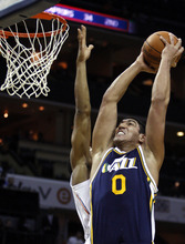 Utah Jazz center Enes Kanter (0), of Turkey, shoots against the Charlotte Bobcats during the first half of an NBA basketball game Wednesday, March 7, 2012 in Charlotte, N.C. (AP Photo/Nell Redmond)