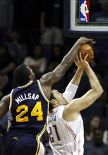 Utah Jazz forward Paul Millsap (24) blocks a shot by Charlotte Bobcats forward Eduardo Najera, of Mexico, during the first half of an NBA basketball game Wednesday, March 7, 2012 in Charlotte, N.C. (AP Photo/Nell Redmond)