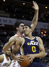 Utah Jazz center Enes Kanter (0), of Turkey, looks for room to drive against Charlotte Bobcats center Byron Mullens in the first half of an NBA basketball game on Wednesday, March 7, 2012 in Charlotte, N.C. (AP Photo/Nell Redmond)