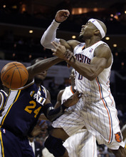 Utah Jazz forward Paul Millsap (24) fouls Charlotte Bobcats forward Corey Maggette during the second half of an NBA basketball game against the Charlotte Bobcats on Wednesday, March 7, 2012, in Charlotte, N.C. Utah won 99-93. (AP Photo/Nell Redmond)