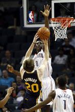 Utah Jazz forward Gordon Hayward (20) shoots over Charlotte Bobcats center Bismack Biyombo, from the Republic of Congo, during the second half of an NBA basketball game on Wednesday, March 7, 2012, in Charlotte, N.C. Utah won 99-93. (AP Photo/Nell Redmond)
