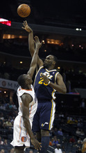 Utah Jazz center Al Jefferson, right, shoots over Charlotte Bobcats center Bismack Biyombo, from the Republic of Congo, during the first half of an NBA basketball game on Wednesday, March 7, 2012, in Charlotte, N.C. (AP Photo/Nell Redmond)