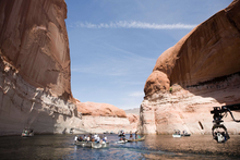 A camera boat on Lake Powell films Carter (Taylor Kitsch) and Dejah (Lynn Collins) as they make their way down the River Iss for a scene in