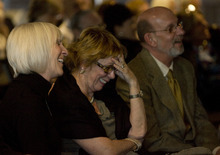 Kim Raff | The Salt Lake Tribune  (from left) Family friend Terri Jackson, Karen Zumbado, and Steve Wirick, son of Richard Wirick laugh as someone tells a funny story about Richard Wirick during a memorial service for him at the Gallivan Hall at Gallivan Plaza in Salt Lake City on March 8, 2012.