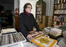 Tribune file photo Helen Radkey is a researcher who has publicized the LDS Church's proxy baptisms of Holocaust victims and Catholic Saints. In this 2009 photograph, she goes through some of her numerous boxes of research files on the baptisms that take up part of an extra bedroom in her home.