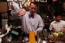 Doug Quinn, left, works at the bar at P.J. Clarke's Thursday, March 8, 2012 in New York. (AP Photo/Tina Fineberg)
