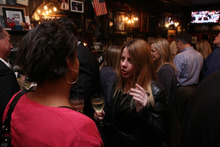 Patrons are seen by the bar at P.J. Clarke's Thursday, March 8, 2012 in New York. (AP Photo/Tina Fineberg)
