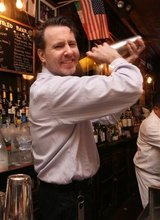 Doug Quinn mixes a drink as he works at the bar at P.J. Clarke's Thursday, March 8, 2012 in New York. (AP Photo/Tina Fineberg)