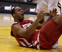 Utah's Chris Hines reacts to a foul call on him during the second half of an NCAA college basketball game against Colorado at the Pac-12 conference championship in Los Angeles, Wednesday, March 7, 2012. Colorado won 53-41. (AP Photo/Jae C. Hong)